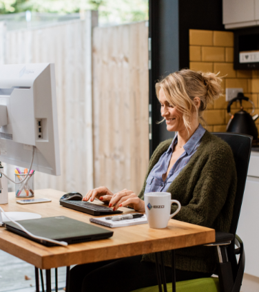 Woman working from kitchen office